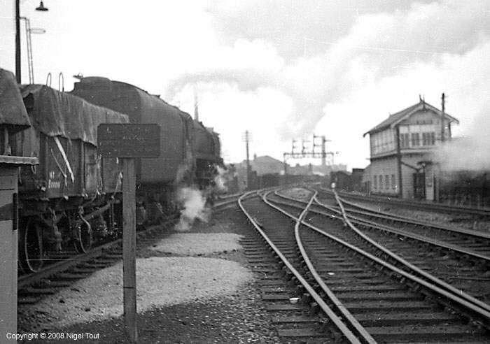 9F on freight train, departing Leicester Central