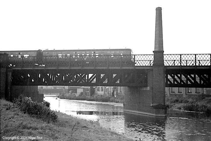 Passenger train to Nottingham, crossing the river Soar just north of Leicester Central station