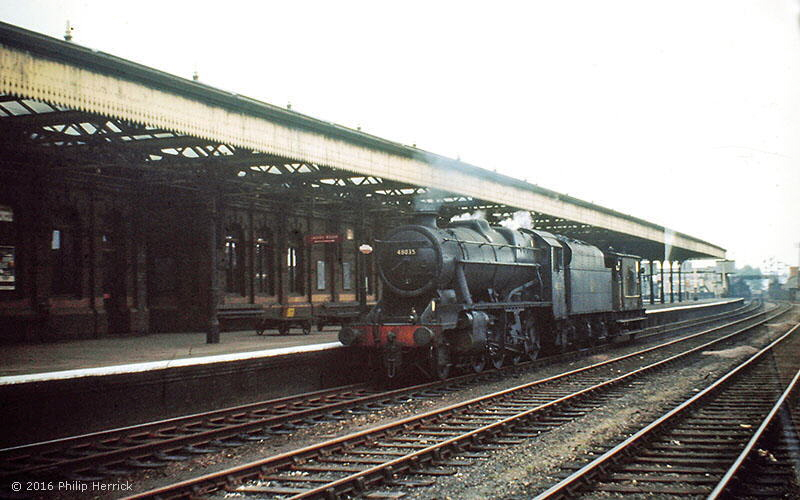 8F 2-8-0 no. 48035 passes through Leicester Central station with a break van in June 1966